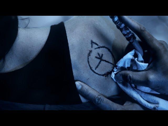 Tina gets a strange tattoo