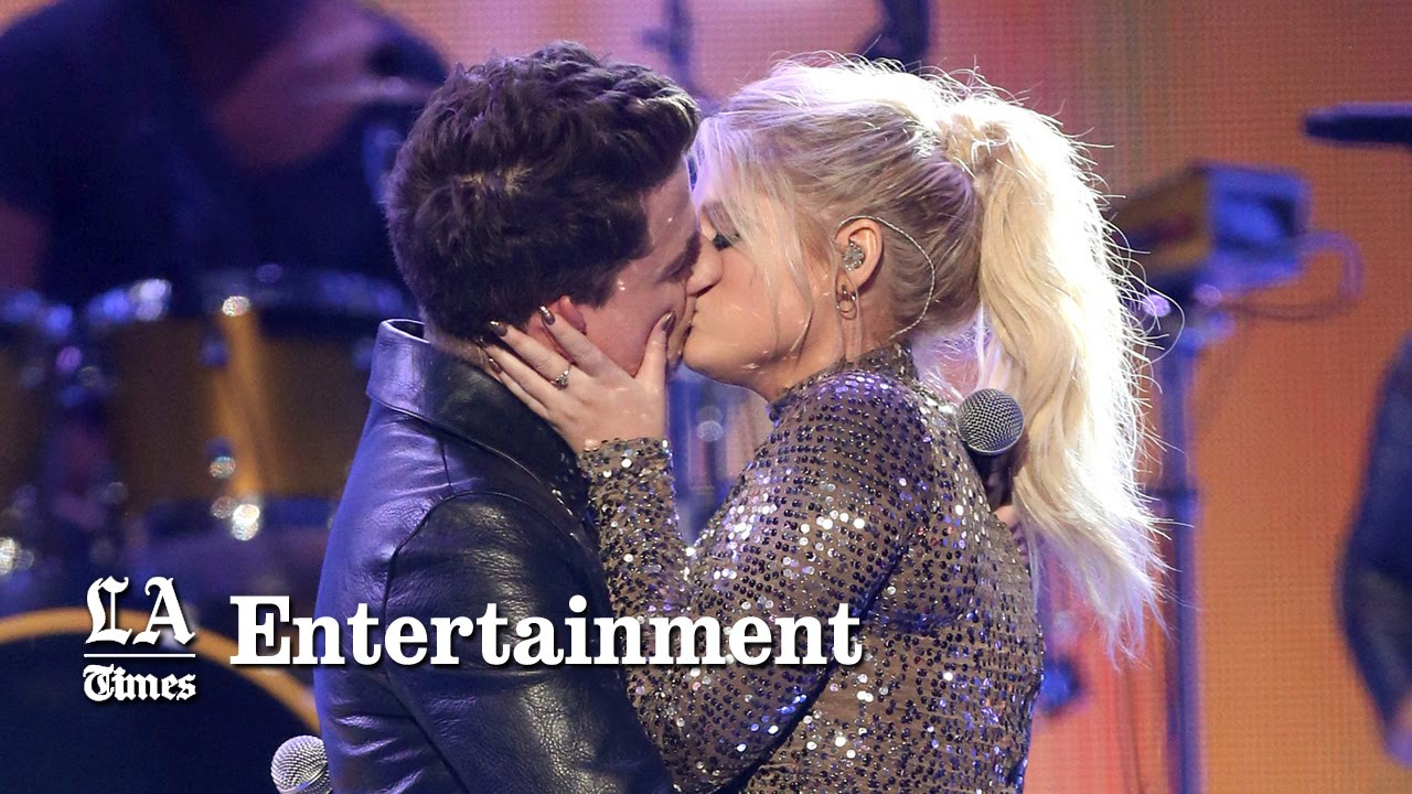 Meghan Trainor and Charlie Puth kiss passionately; are just friends ...: www.youtube.com/watch?v=vNTec5uwvv4