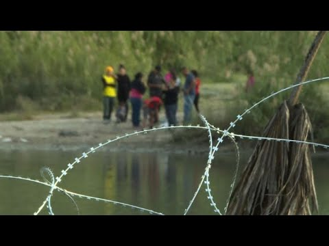US military place barbed wire at the border with Mexico