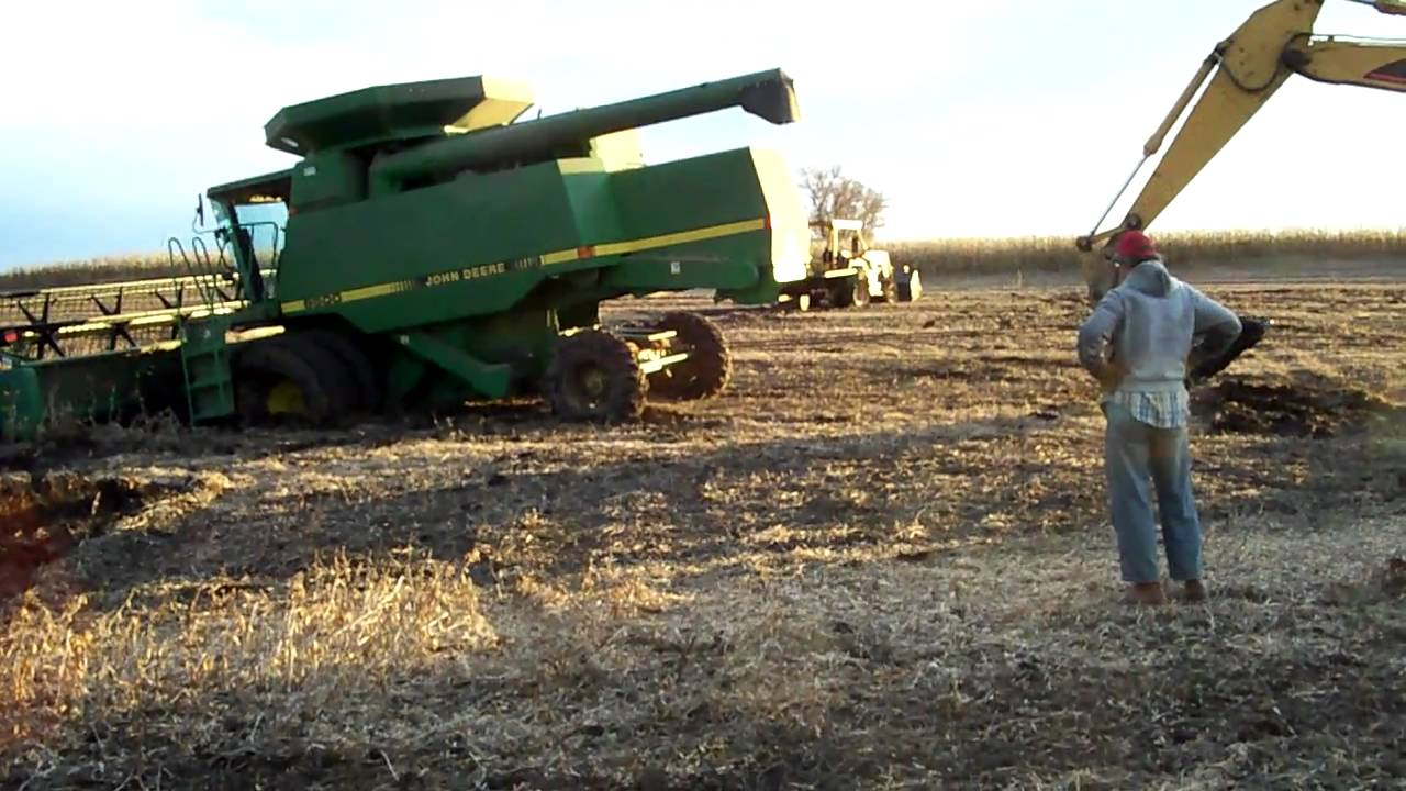 John Deere Combine stuck in the bean field. - YouTube