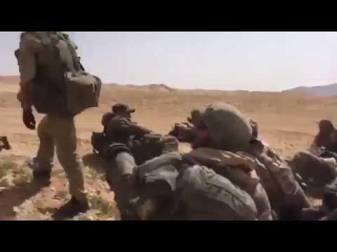 Russian Advisers/Soldiers watching RuAF Mi-35/24 work in Syrian desert,Eastern Homs.