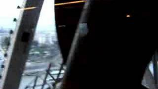 Inside a descending Eiffel Tower elevator