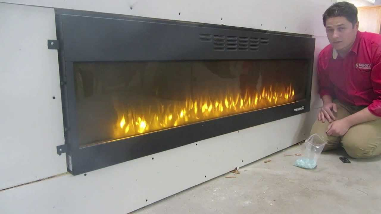 http://blazingembers.com/napoleon-allure-series-electric-fireplace/ Not sure how to install your electric fireplace? Watch our video to see how to flush moun...