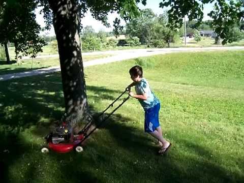 kid mowing lawn