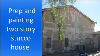 Exterior painting of two story stucco house.