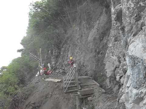 Rippping out the old Kalaupapa trail bridge by helicopter