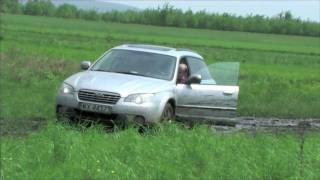 Two Subaru Outbacks on slippery mud - HD