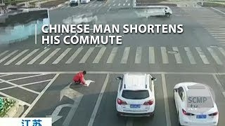 A chinese man was fined after repainting road markings to shorten his bus commute at busy junction in eastern china's jiangsu province.