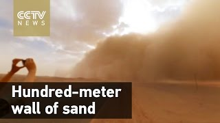 Watch: hundred-meter-high wall of sand engulfs Inner Mongolia