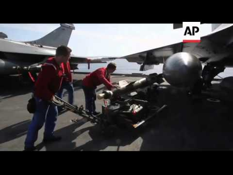 Scenes from on board French aircraft carrier, planes take off