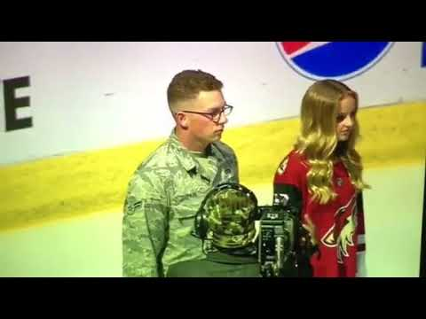 Evie Clair performing the National anthem at the Arizona cayotes game.