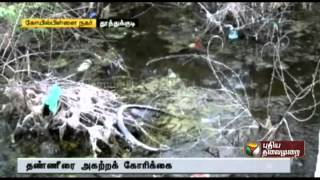 People stress to remove drainage water in residence area at Tuticorin