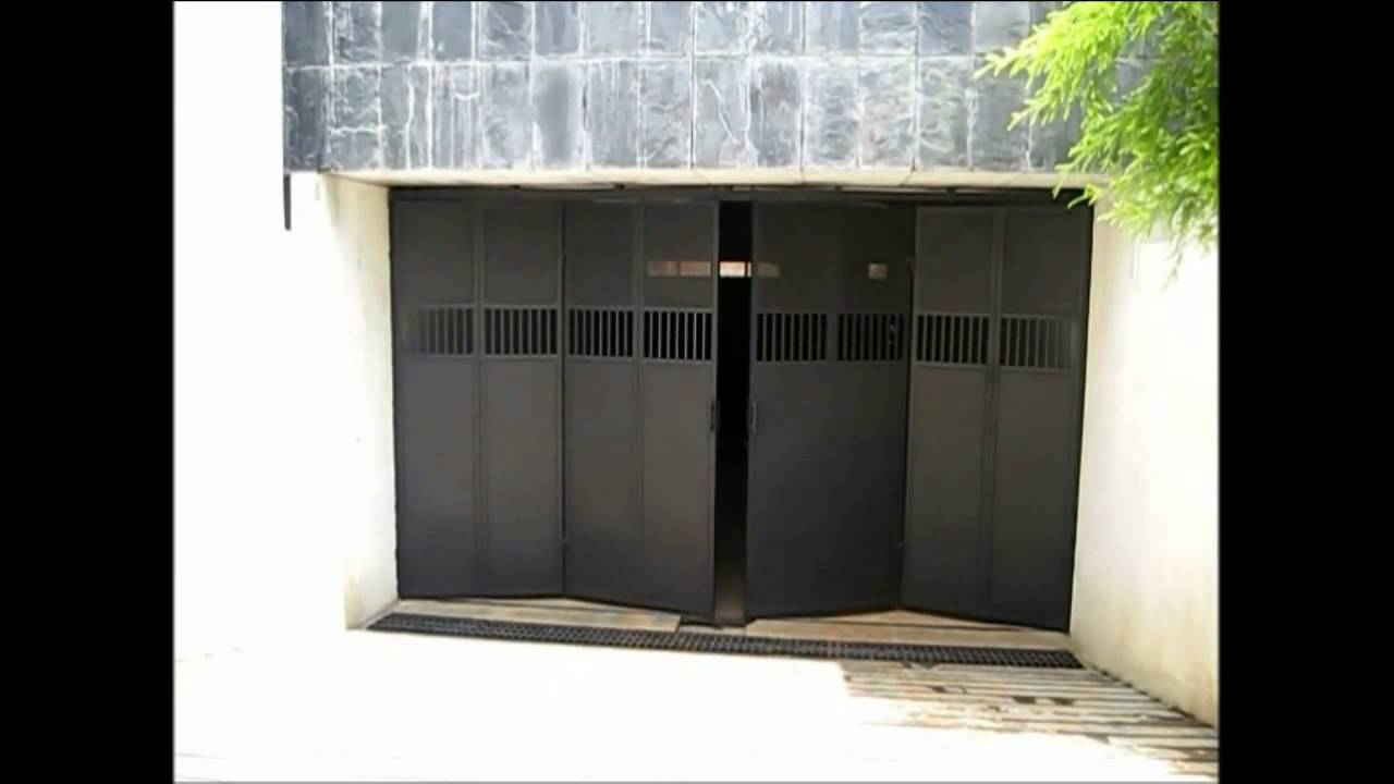 Quality automations folding garage door youtube