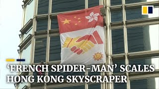french spider man scales hong kong skyscraper