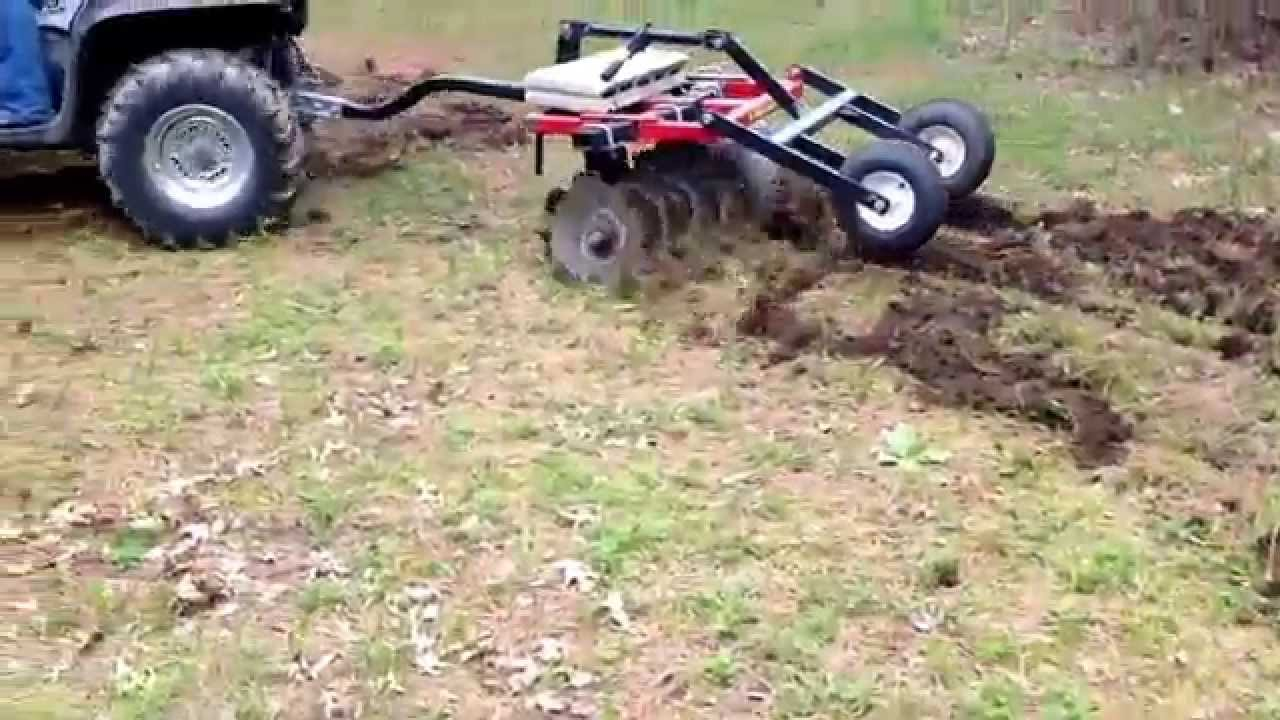 ATV putting in food plots with a Howse ATV disc harrow YouTube