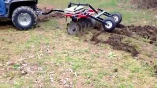 ATV putting in food plots with a Howse ATV disc harrow.