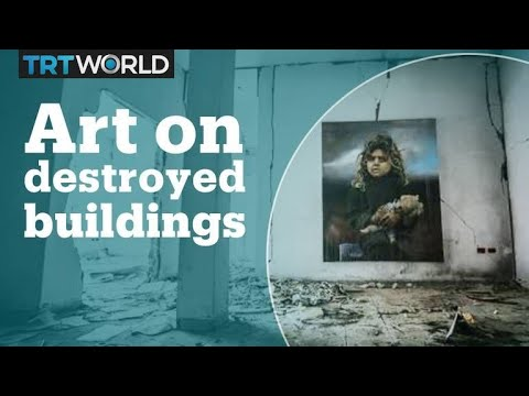 Meet the Palestinian artist who paints on destroyed buildings in Gaza