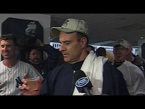 Joe Torre offers a toast after winning the 2001 ALCS