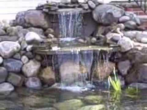 Koi pond in front yard project new jersey youtube for Tiered pond waterfall