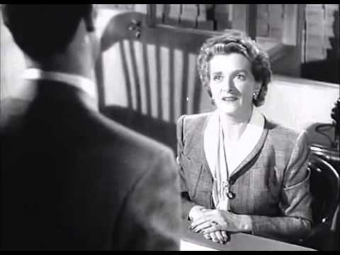 Gladys Cooper with long nails in the film Mr  Lucky 1943
