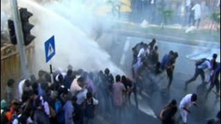 Police fire tear gas on protesting university students