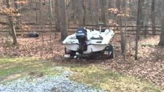 Warn M8000 pulls boat and trailer out of the woods.