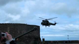 Royal Air Force Puma Helicopter lands in a windy l/z  at Carrickfergus Castle 30/6/12