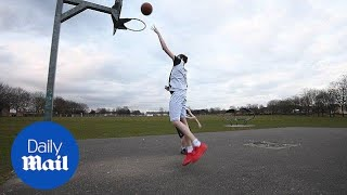 Britain's tallest teenager at 7ft 3ins plays basketball - Daily Mail