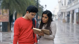 Cute Indian girl enjoying reading a book with her boyfriend - lifestyle concept