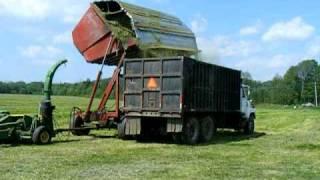 Dump cart dumping into dump truck