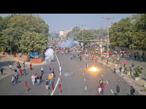 Tear gas fired at Indian tractor rally as farmers march to c