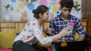 Indian girl irritates her boyfriend who is working on his laptop