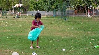 Young volunteer cleaning up garbage to reduce environmental issues - ecology concept