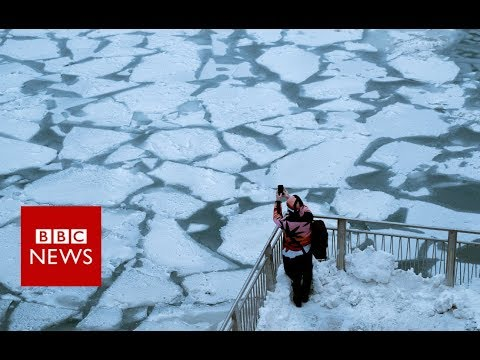 Video: The Chicago River freezes as the polar vortex hits US Midwest
