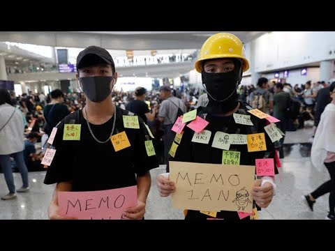 Hong Kong protesters occupy main airport