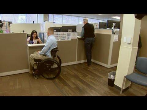 Wheelchair-bound man helps change parking ticket law