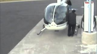 Helicopter stopping at gas station