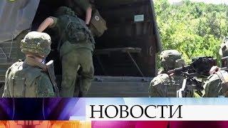 В Донбассе у станицы Луганская началось разведение сил.