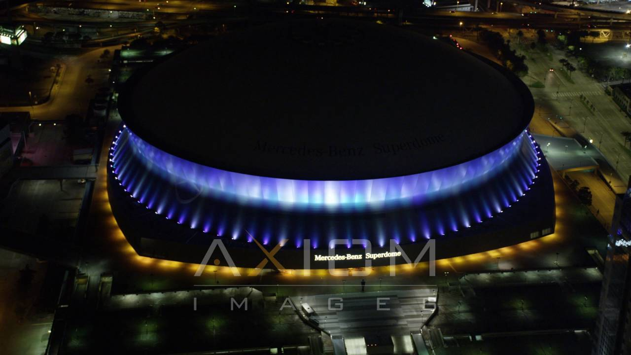 mercedes-benz superdome at night, new orleans aerial stock footage