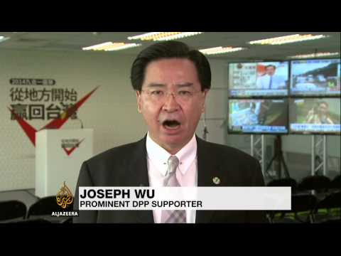 Taiwan PM quits after election losses
