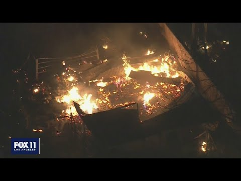 Fire still burning after fireworks explosion kills 2 in Ontario