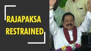 Breaking News: Sri Lankan court restrains Mahinda Rajapaksa from acting as PM
