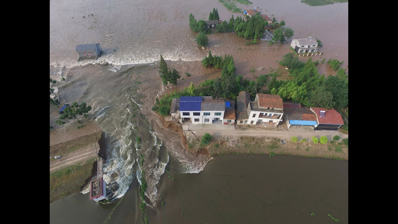 Ferocious mountain floods crash down onto China village