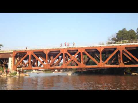 Jumping Bridge into water at port credit Mississauga Ontario