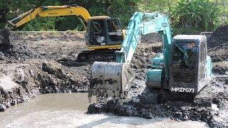 Mini excavator digging pond kobelco sk75 komatsu pc60. related videos : accident sk200 fuso self loader truck heavy recovery https://www.yo...