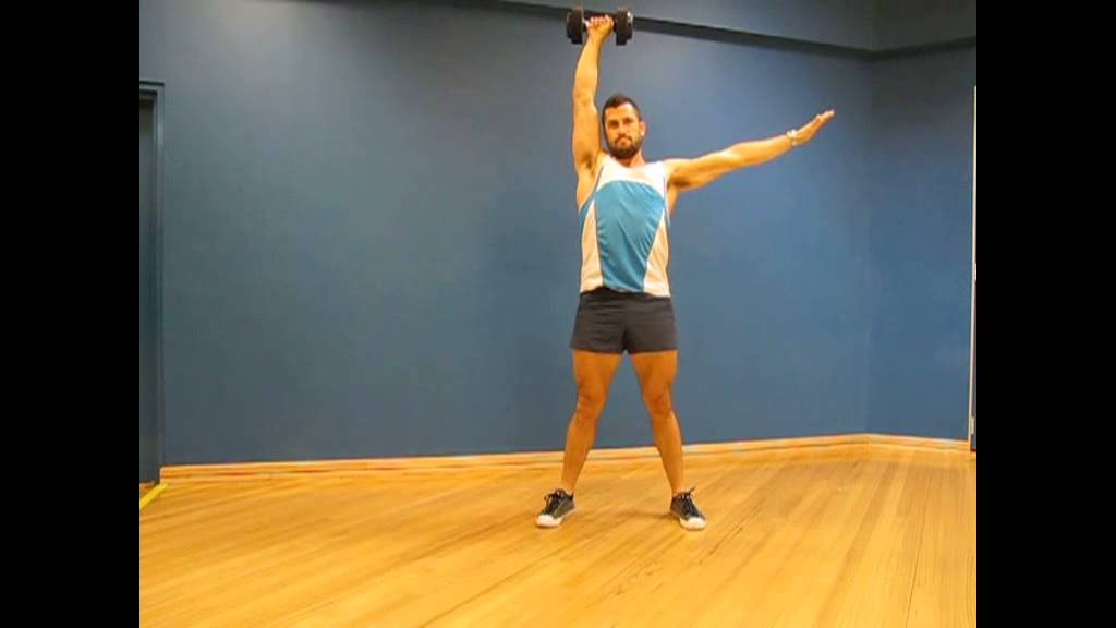 Single arm dumbbell squat to press
