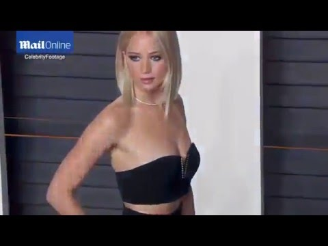 Jennifer Lawrence flashes abs at Vanity Fair Oscars party