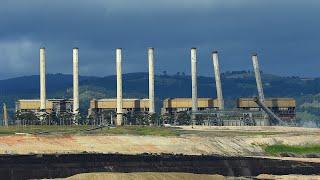 video: Watch: Eight power station chimneys demolished in Australia