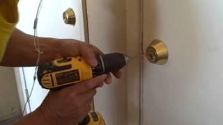 drilling open a dead bolt.AVI
