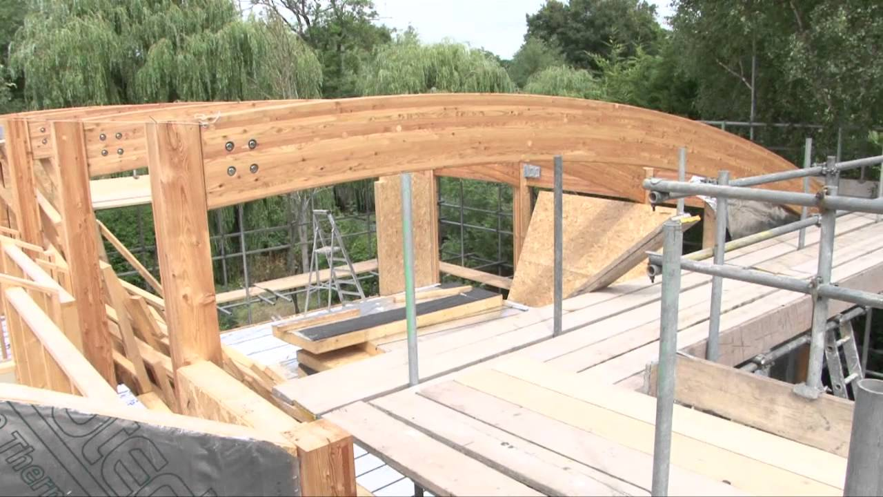 Contemporary design custom timber frame house youtube for Contemporary timber frame home plans